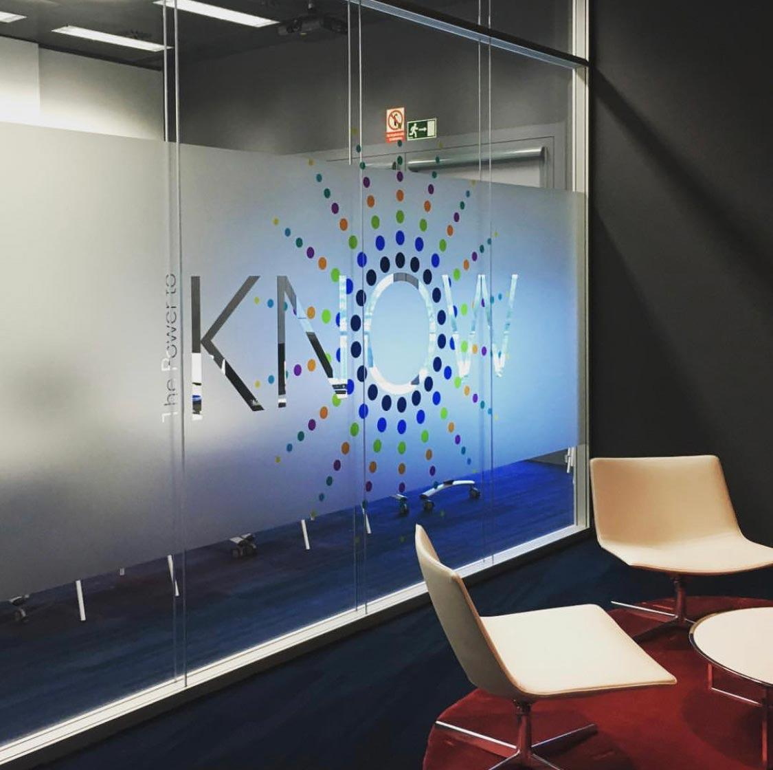 Know Graphic on Glass Wall
