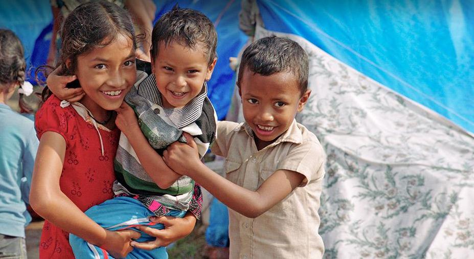 Three kids smiling in Nepal